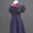 1950s Era dress from the exhibit, THREADS: the Story in Our Clothes
