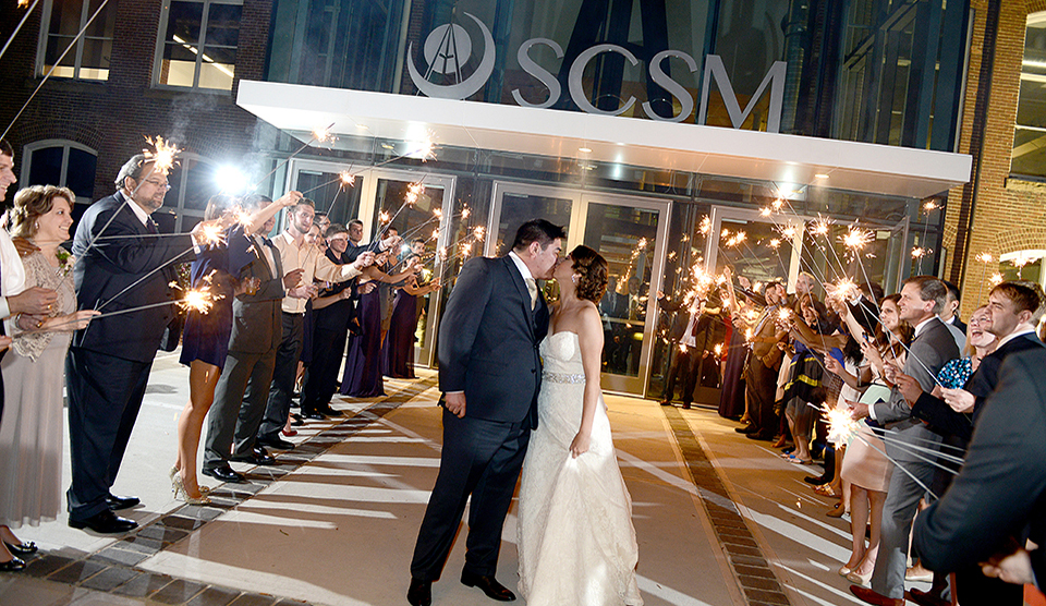 A Bride and Groom outside the SC State Museum after dark.
