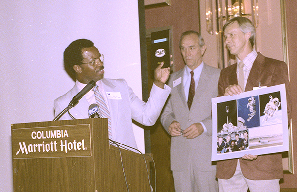 McNair presents his notebook for shuttle mission STS-41B to the State Museum in 1985
